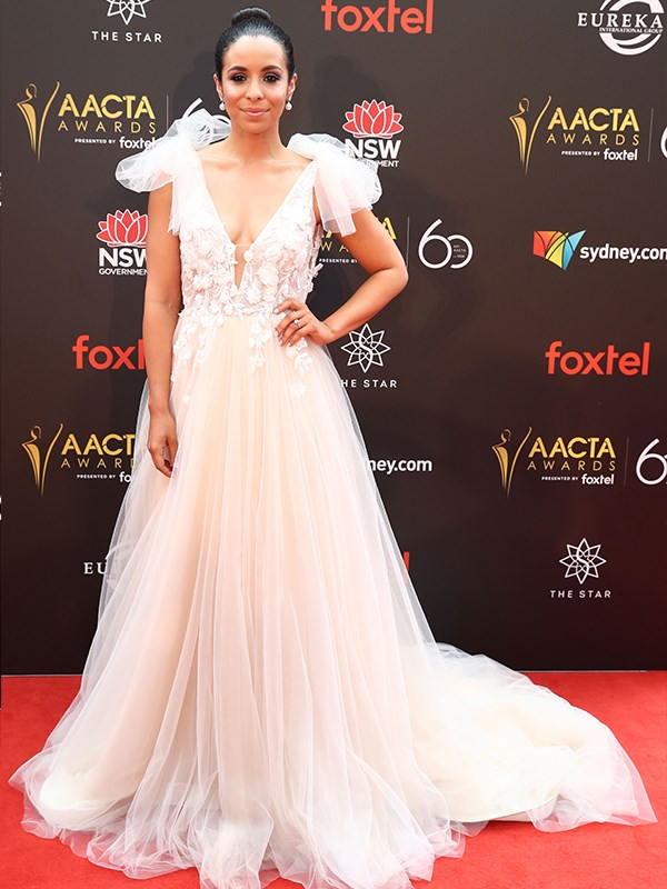Actress Kat Hoyos dazzles in this incredible creation by Antelia Sydney featuring a custom bow and shoulder detail. *(Image: Getty)*