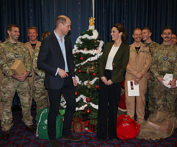 The Duke and Duchess joked as they handed out presents to serving personnel. *(Image: Getty Images)*