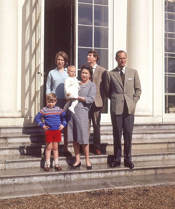 We recognise those stairs! Decades earlier in 1965 The Queen and Prince Philip posed with their children Prince Andrew, Princess Anne, a baby Prince Edwards and Prince Charles on the steps of Frogmore House. *(Image: Historia/REX/Shutterstock)*