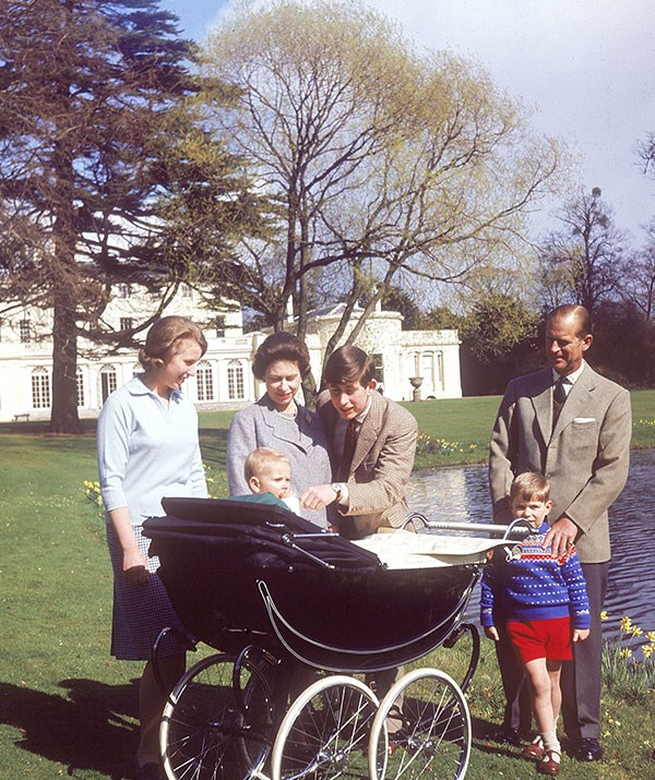 Queen Elizabeth and her family push one-year-old Prince Edward around Frogmore House in 1965. *(Image: Historia/REX/Shutterstock)*