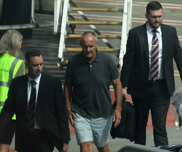 Chris Dawson being escorted by police in Sydney on Thursday. *(Source: AAP)*