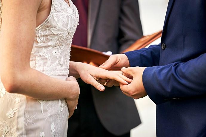 The happy couple exchange rings.