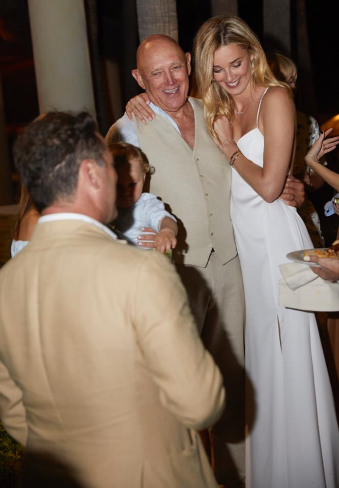 Jasmine (pictured here with her Dad), looking radiant in white at their welcome party. *(Source: Supplied)*