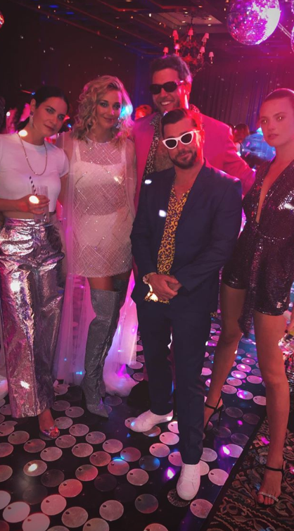 Jasmine, pictured second from the left, partied it up with her friends at the Studio 54 themed party. *(Image: Instagram / @corbinharris)*