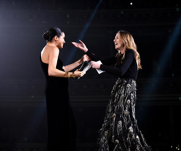 The Duchess of Sussex presented Claire Waight Keller with her award for British Womenswear Designer of the Year. *(Image: Getty Images)*