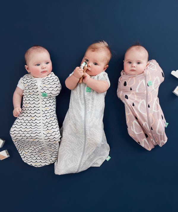 If swaddling with a piece of fabric is proving tricky, use a zip-up swaddle. *Image: ErgoPouch Australia