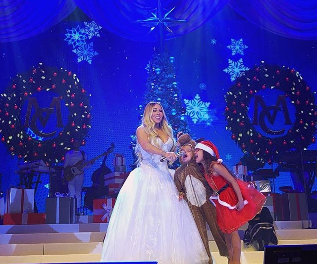 She's the unofficial Queen of Christmas and this year, Mariah Carey is getting some help from her own cute elves, twins Morocco and Monroe, both six. *(Image: @mariahcarey Instagram)*