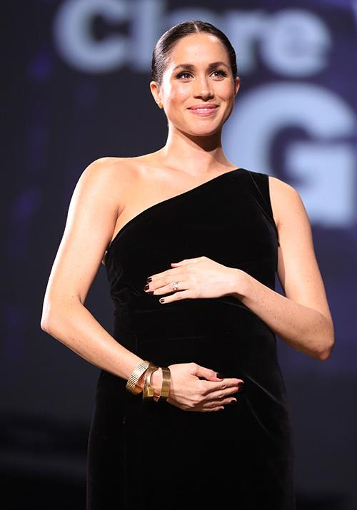 During the event, Meghan presented the British Womenswear Designer of the Year award to Claire Waight Keller of Givenchy - the very person behind her wedding dress. *(Image: Getty Images)*