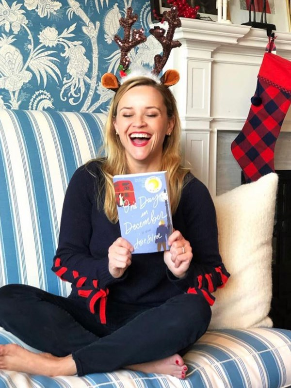 *Legally Blonde* star Reese Witherspoon is cosying up this silly season with some of her favourite books. *(Image: @reesewitherspoon Instagram)*