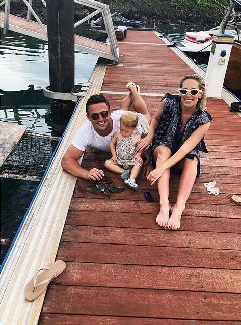 Sam and Phoebe Burgess with their super cute daughter Poppy. *(image: Instagram/@mrsphoebeburgess)*.