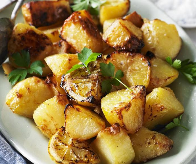 "**The perfect lemon roast potatoes** <br><br> Baked with lemon, this is the perfect roast potatoes recipe to add to your dinner repertoire. By adding par-boiled floury potatoes to a hot, oiled baking tray with lemon, these potatoes become perfectly crisp on the outside, fluffy on the inside, with a delicious hint of citrusy brightness. <br><br> See the full *Australian Women's Weekly* recipe [here](https://www.womensweeklyfood.com.au/recipes/roast-potatoes-recipe-9550|target=""_blank""