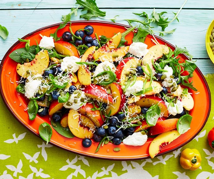 """**Summer salad of peaches and blueberries** <br><br> Team your favourite fresh summer fruit with creamy ricotta, fresh spinach leaves, basil and chilli for a unique, delicious side dish for any outdoor gathering. <br><br>  See the full *Australian Women's Weekly* recipe [here](https://www.womensweeklyfood.com.au/recipes/summer-salad-of-peaches-and-blueberries-2887