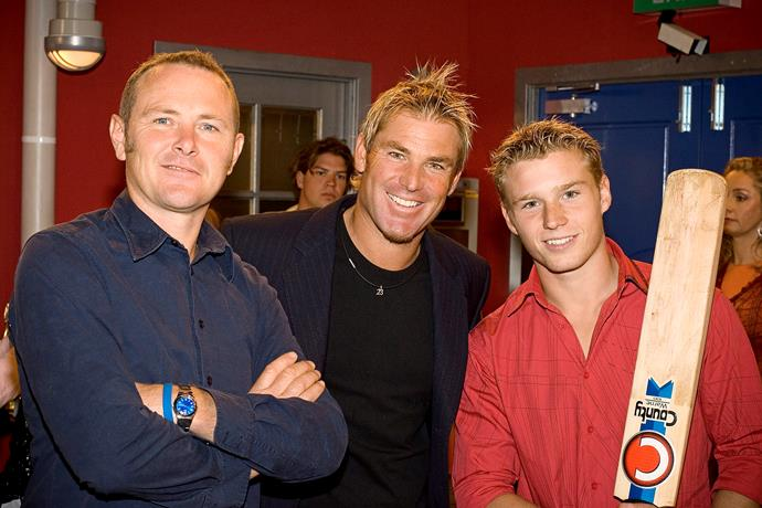 **38) SHANE WARNE BOWLS ERINSBOROUGH OVER** <br><br> In 2006, cricket legend Shane Warne (here with Boyd Hoyland) made his first TV cameo when he came to Erinsborough to collect a charity cheque.