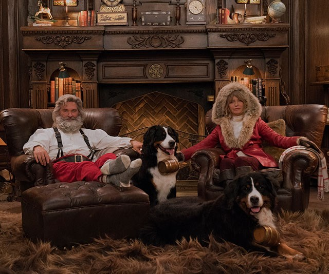 We've never seen so much Christmas swagger in one photo! Hollywood power couple Kurt Russell and Goldie Hawn pose as sassy Santa and Mrs Claus to celebrate *Netflix*'s new film *The Christmas Chronicles*, which stars Kurt. *(Image: Michael Gibson/Netflix)*
