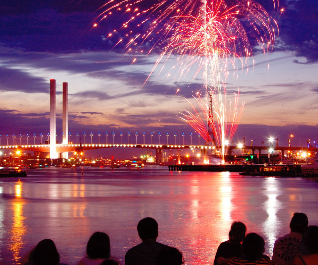 **Yarra Park, (use Richmond or Jolimont Stations):** Perhaps the best option for families looking to settle in for a long night thanks to the big screens and entertainment on offer while you wait. *Image: Melbourne fireworks Getty Images.*