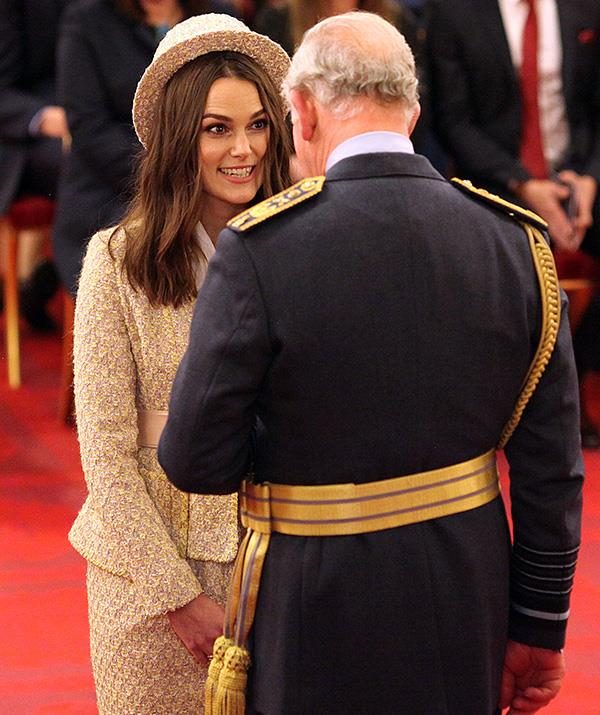 Keira stared up at the royal with excitement as she was presented with her OBE. *(Image: Getty)*