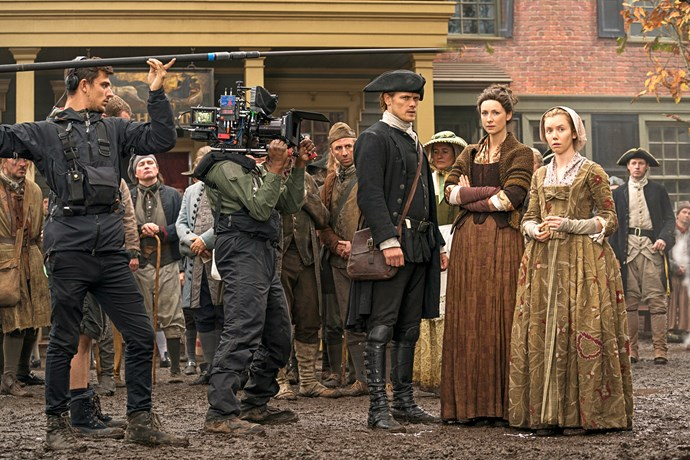 A behind the scenes look at Sam and Caitriona filming a scene.