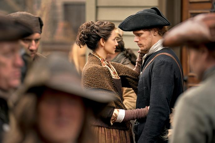 A lover's gaze between Claire and Jamie in a scene from season four.