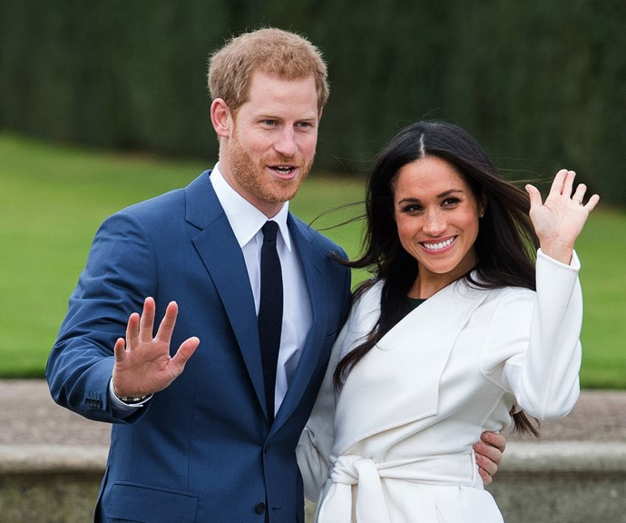 Prince Harry and Duchess Meghan during their engagement photoshoot. *(Image: Getty)*