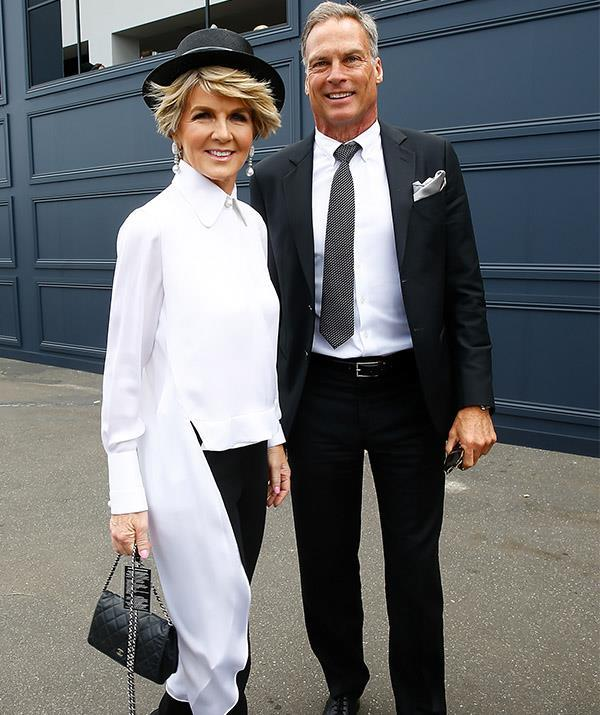 Julie well and truly embraced preppy chic on Derby Day in Melbourne - her top hat finishes off her look perfectly. *(Image: Getty)*