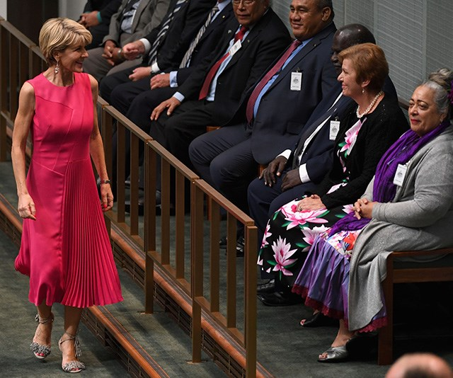The very same week, Julie wore this bright ensemble that made a bold statement at Parliament House *(Image: Getty)*