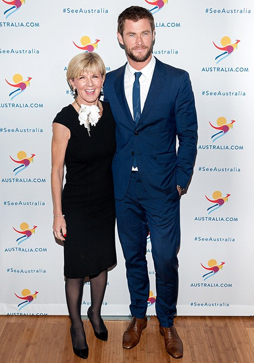 And speaking of A-list pals, Bishop accessorised her chic LBD with a statement flower necklace... and none other than Chris Hemsworth! *(Image: Getty)*