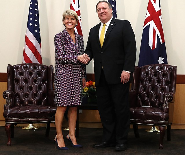 A power jacket and a dazzling smile is all you need to make a good impression - here Julie shakes hands with U.S. Secretary of State Mike Pompeo. *(Image: Getty)*