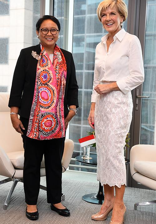 Bishop opted for a trendy all-white ensemble when she met her Indonesian counterpart, foreign minister Retno Marsudi. *(Image: Getty)*