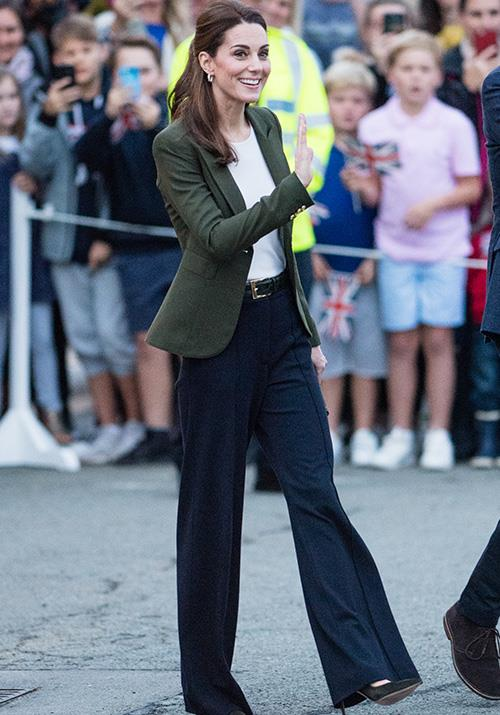 Donning pants is a bit of a rarity for the Duchess, but she looked every bit the fashion icon she is in her Smythe blazer paired with flared trousers. She wore the ensemble during a visit to Cyprus in December. *(Image: Getty)*