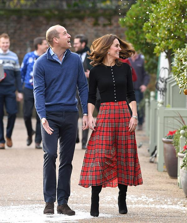 """New Zealand-born designer Emilia Wickstead created this gorgeous tartan skirt worn by Kate during a December [Christmas party](https://www.nowtolove.com.au/royals/british-royal-family/kate-middleton-christmas-tartan-52866