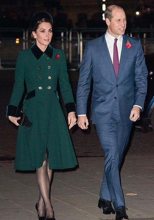 Kate wore a forest green Catherine Walker coat for a Remembrance Day service in November. She paired the look with a stunning headpiece by Jane Taylor. *(Image: Getty)*