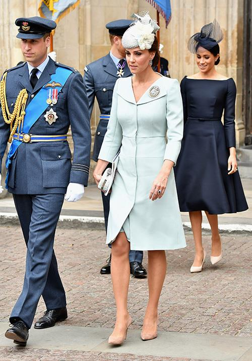 In a surprise appearance, Kate stepped out in July to attend an event marking the centenary of the RAF. Her light blue Alexander McQueen wool trench was subtly chic. *(Image: Getty)*