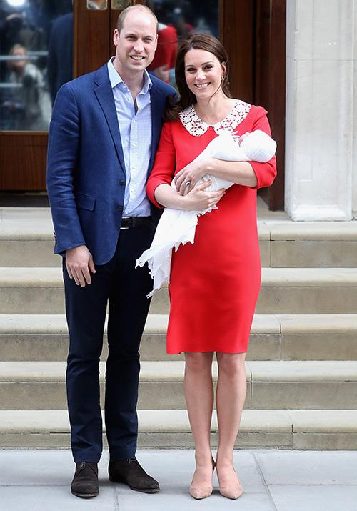 Doting parents indeed! Mere hours after giving birth to Prince Louis, Duchess Catherine stepped out looking radiant in a Jenny Packham number, accompanied by two very prominent males! *(Image: Getty)*