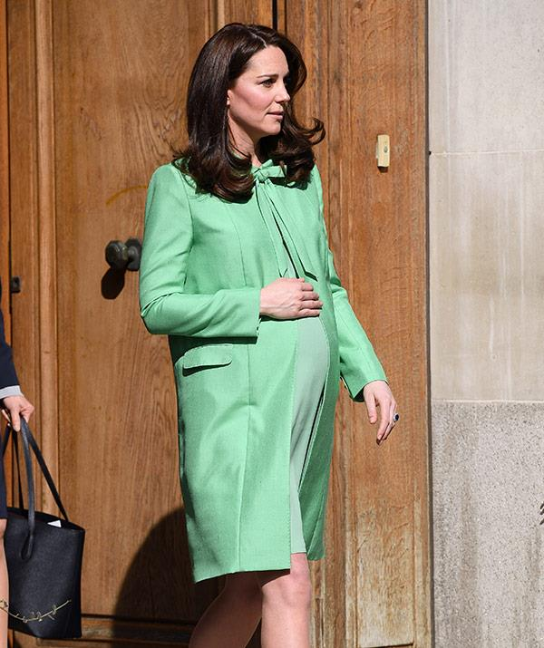 In one of her final appearances before giving birth to Prince Louis, Kate stepped out in this bright green ensemble by her beloved British designer Jenny Packham in March. *(Image: Getty)*