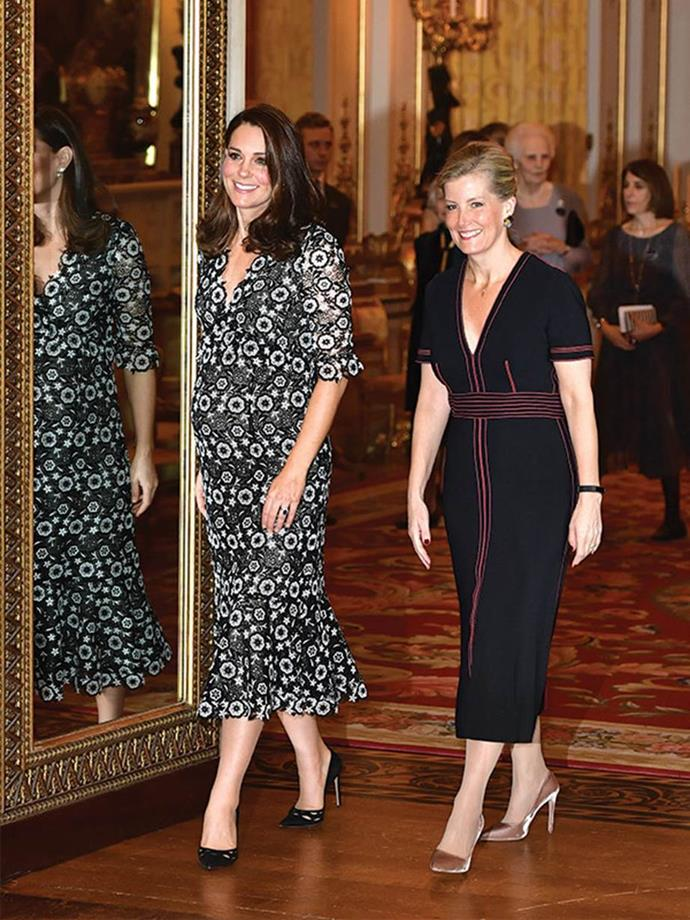 """Kate's stunning black-and-white lace floral print dress by UK designer Erdem was a vision next to the always-stylish Sophie, Countess of Wessex as the pair [co-hosted the Commonwealth Fashion Exchange](https://www.nowtolove.com.au/royals/british-royal-family/the-royals-have-a-glorious-time-out-and-about-20018