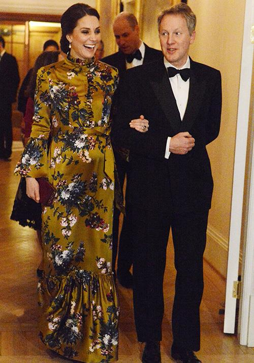 The Duchess cut an elegant figure in this stunning Erdem gown, which featured a floral print, frilled collar and flared sleeves. Kate opted for the stylish frock as she attended a VIP reception dinner during her visit to Sweden in January. *(Image: Getty)*