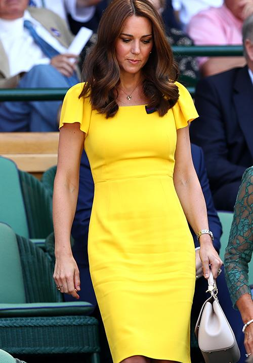 It's a big call, but this yellow Dolce & Gabbana number worn by the Duchess for the Wimbledon final in July might be our favourite of the year - she looks incredible, and just months after giving birth to Prince Louis! *(Image: Getty)*