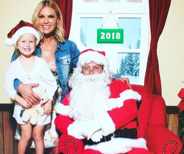 """Me: 'Hi Santa.' Santa: 'I know you..... you've been very naughty.'"" Sonia Kruger and her darling daughter Maggie pay a visit to Santa. *(Image: @soniakruger Instagram)*"
