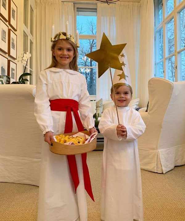 Princess Victoria of Sweden's two children, Princess Estelle, six, and Prince Oscar, two, make for the sweetest Christmas nativity angels. *(Image: @kungahuset Instagram)*