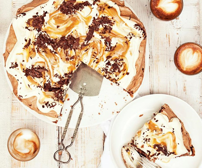 "**Chocolate pavlova with salted butterscotch sauce** <br><br> The humble Aussie pavlova is made even more decadent when swirled with flaked chocolate and served with a rich, creamy topping. Drizzle over a homemade salted caramel sauce to create utter dessert heaven. <br><br> See the full *Australian Women's Weekly* recipe [here.](https://www.womensweeklyfood.com.au/recipes/chocolate-pavlova-with-salted-butterscotch-sauce-28116|target=""_blank"")"