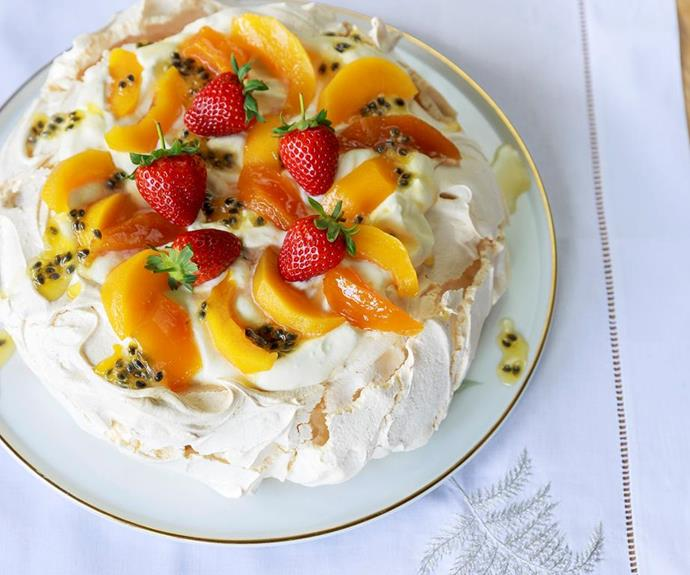 "**Classic pavlova with spiced peaches and preserved passionfruit** <br><br> Utilise the beautiful summer stone fruit currently in season to top this delicious classic pav.  <br><br> See the full *Australian Women's Weekly* recipe [here.](https://www.womensweeklyfood.com.au/recipes/classic-pavlova-with-spiced-peaches-and-preserved-passionfruit-24687|target=""_blank"")"