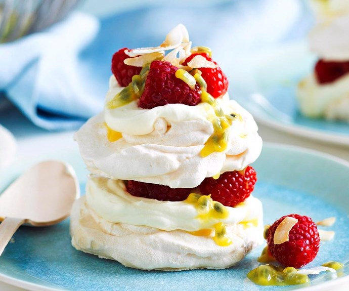 """**Coconut pavlova stacks** <br><br> The coconut lifts these little mini pavlovas to create the perfect summer dessert.  <br><br> See the full *Australian Women's Weekly* recipe [here.](https://www.womensweeklyfood.com.au/recipes/coconut-pavlova-stacks-17778
