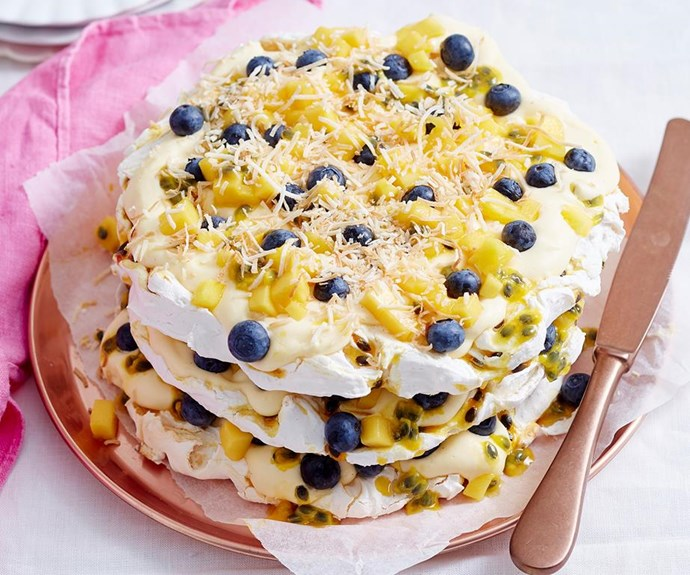 "**Tropical coconut pavlova stack** <br><br> This light pavlova, with fresh tropical fruits stacked between melt-in-your-mouth meringues, is the perfect dessert for entertaining this summer season! <br><br> See the full *Australian Women's Weekly* recipe [here.](https://www.womensweeklyfood.com.au/recipes/tropical-coconut-pavlova-stack-1836|target=""_blank"")"