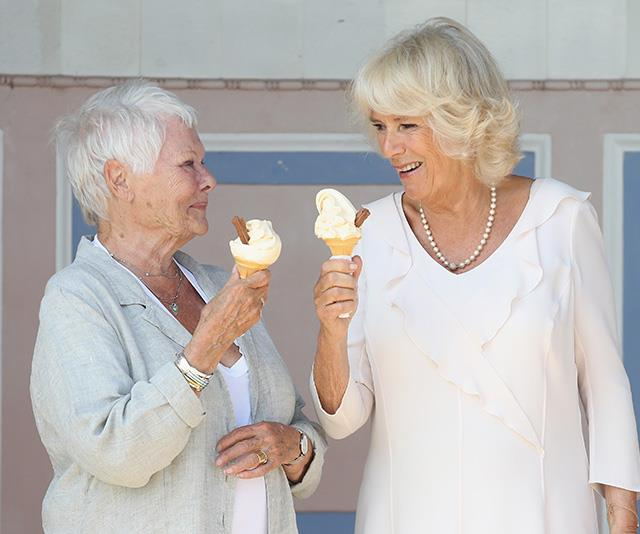They wouldn't be royals without their string of A-list pals - and this candid moment of Camilla and remowned British actress Dame Judi Dench was a real treat for Chris to capture in July. The pair ate ice creams together as they visited Queen Victoria's private beach in East Cowes England. *(Image: Chris Jackson / Getty Images)*