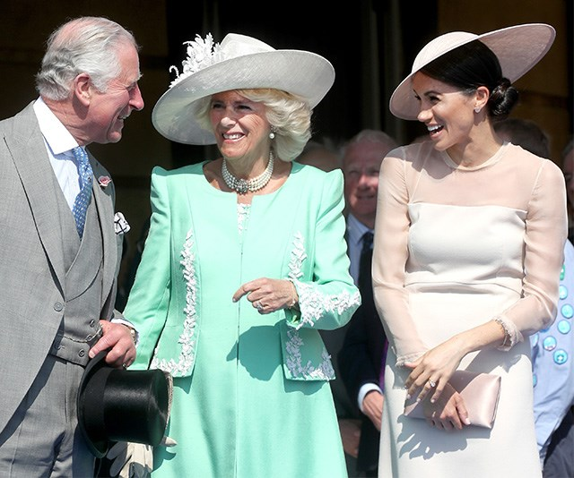 In her first post-wedding appearance in May, Meghan stood with Charles and Camilla as they attended the Prince of Wales' 70th Birthday Patronage. The three royals were captured having a good old chuckle together, making it clear the new Duchess had already hit it off with her in-laws. *(Image: Chris Jackson / Getty Images)*