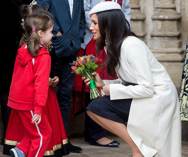 """Shortly before the royal wedding, Chris captured the soon-to-be Duchess of Sussex sharing a sweet moment with a young girl at the Commonwealth Day service in March.  <br><br> The moment was a poignant one for Chris, who has watched Markle's evolution into a royal unfold before his very eyes: """"I've loved capturing these moments and seeing her grow into the role of the Duchess of Sussex throughout this year,"""" he said. *(Image: Chris Jackson / Getty Images)*"""