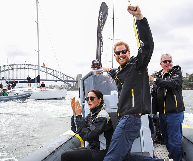 During the Invictus Games, Meghan and Harry set sail on Sydney Harbour, where Chris captured a special moment where the pair cheered on competitors. *(Image: Chris Jackson / Getty Images)*