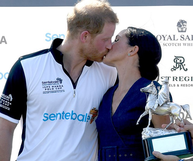 In a rare royal moment, Chris captured a sweet kiss between the newly wedded Harry and Meghan as they attended a polo match in July - this image will no doubt be shared for years to come! *(Image: Chris Jackson / Getty Images)*