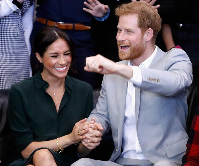 Travelling to Sussex in early October, Harry and Meghan visited a youth centre where Chris captured this gorgeous candid moment. Harry is seen cheering while Meghan bursts into laughter. *(Image: Chris Jackson / Getty Images)*