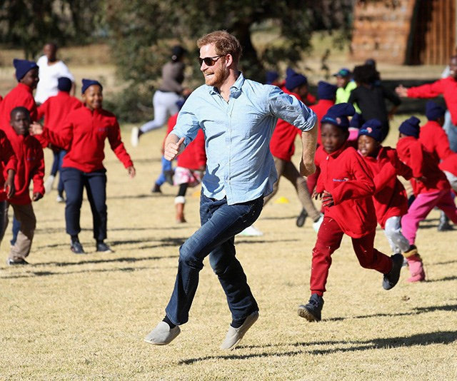 Ever the young-soul, Prince Harry ran amok with school children as he visited Maseru, Lesotho in June shortly after his royal wedding. *(Image: Chris Jackson / Getty Images)*